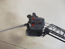 Fighting fires from a distance stock photography
