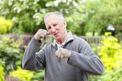 Fighting fit old man in garden Stock Photo