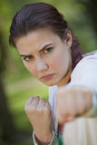 Fighting fitness woman Stock Photos