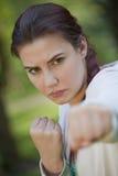 Fighting fitness woman stock photos