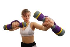 Fighting fitness woman with barbells. Isolated fighting fitness woman with barbells Stock Image