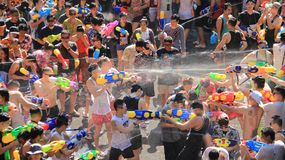 Fighting For Fun. Water Fight  Or Songkran  Festival. Combat for fun. Tourist happy with splash water on songkran day or thai new year  celebrated  local Royalty Free Stock Image