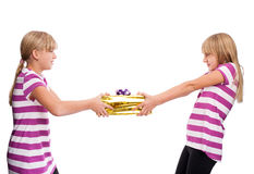 Fighting for a gift. Gift/Two girls are fighting for a gift royalty free illustration