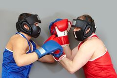 Fighting in helmets Royalty Free Stock Photo