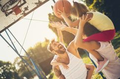 Fighting for his team. Family playing basketball. Close up royalty free stock photography