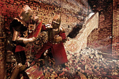 Fighting knights. Knights battle in the ruins Stock Photos