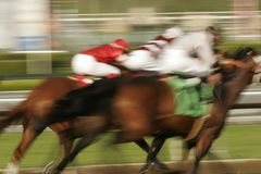 Fighting for the Lead. Abstract motion blur of jockeys struggling for the lead in a horse race royalty free stock photos
