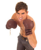Fighting man in boxing gloves Stock Photos