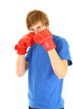 Fighting man in boxing gloves Stock Image