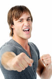 Fighting man with fists. Scary man with fists clenched boxing towards camera showing agression Royalty Free Stock Photos