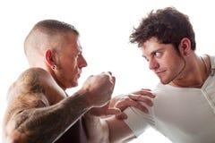 Fighting men Stock Images