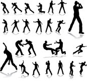 Fighting men. Silhouettes. Set of silhouettes of  the fighting men isolated on a white Royalty Free Stock Photo