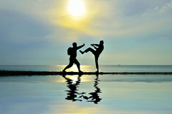 Fighting near beach Royalty Free Stock Images