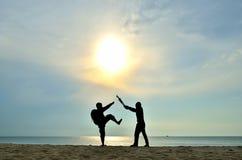 Fighting near beach Stock Photos