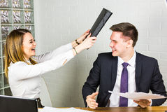Fighting in the office royalty free stock photo