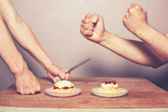 Fighting over cream tea Royalty Free Stock Image
