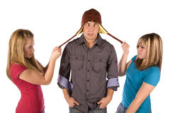 Fighting over hat Royalty Free Stock Image