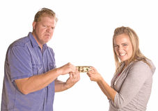 Fighting over money Royalty Free Stock Images