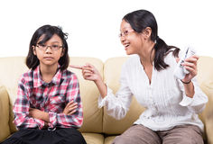 Fighting Over Remote Control II. Sisters fighting over remote controls on a sofa royalty free stock photography