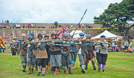 Fighting with pikestaffs Royalty Free Stock Photo