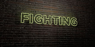FIGHTING -Realistic Neon Sign on Brick Wall background - 3D rendered royalty free stock image Royalty Free Stock Photo