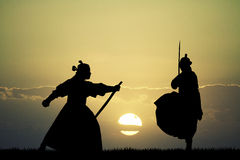 Fighting Samurai at sunset. Illustration of samurai at sunset Royalty Free Stock Images