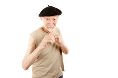 Fighting senior man in beret Royalty Free Stock Photo