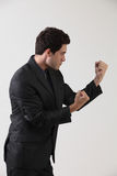 Fighting stance. Businessman in martial arts fighting stance royalty free stock images