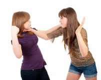Fighting teen girls isolated. Over white background Stock Images