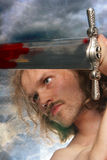 Fighting warrior. Over cloudy background Royalty Free Stock Image