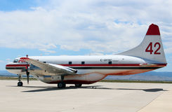 Fighting Wildfire in the Rocky Mountains. An air tanker covered in retardant sits on the tarmac during Colorado's wildfire season Stock Photo