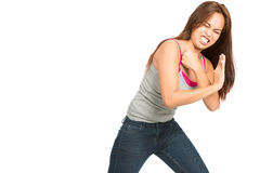 Fighting Woman Body Pushing Against Side Object H. Struggling Asian woman clenched teeth pained face in casual clothes leaning, driving back and pushing against Royalty Free Stock Images