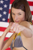 Fighting woman over american flag Royalty Free Stock Photography
