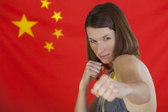 Fighting woman over china flag Stock Photo