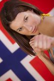 Fighting woman over norwegian flag Stock Photos