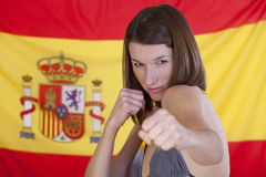 Fighting woman over spain flag Royalty Free Stock Image