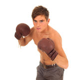 Fighting young man with boxing gloves Royalty Free Stock Photos