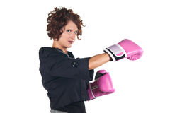 Fighting for your business. Pretty business woman with boxing gloves Royalty Free Stock Images