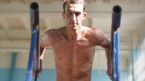 Fights without rules-mixed martial arts training. Athlete training mixed martial arts on the bars. Work hand muscles and muscles of the torso and back. Ultra stock video footage