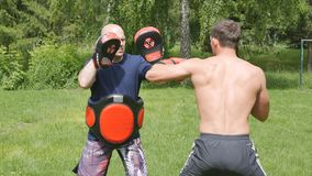 Fights without rules-mixed martial arts training stock video
