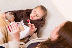 Figlia ammalata Fotografia Stock