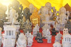 Figra is a golden buddha and figures of other gods, Ganesha. India royalty free stock photography