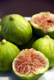 Figs. Fresh figs the focus is on the red fig halved stock images