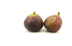 Figs. Two figs on a white background Royalty Free Stock Photos