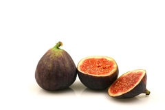 Figs. Two figs and a sliced one on a white background Royalty Free Stock Photo