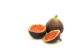 Figs. A fig and a sliced one on a white background Stock Image