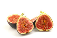 Figs. Two sliced figs on a white background Stock Photos