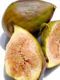 Figs. One fig and two halfs on a white background Royalty Free Stock Image