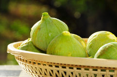 Figs. Closeup of a basket with some green figs Stock Photo