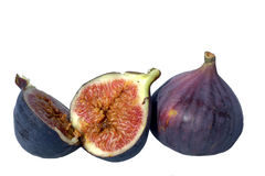 Figs. Split and whole figs isolated on white Royalty Free Stock Photos
